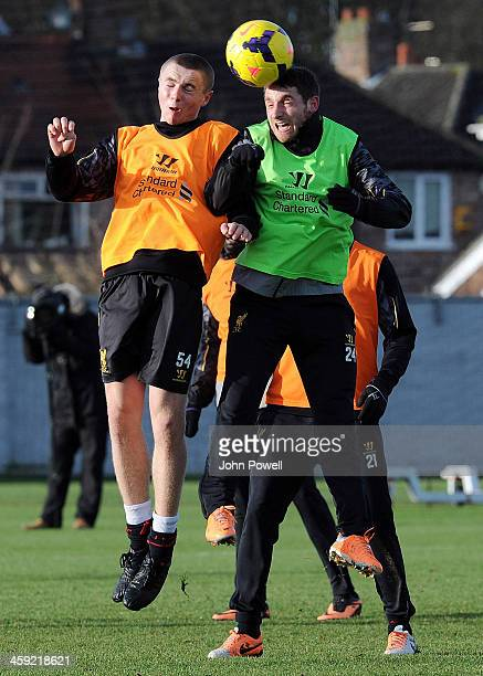 Jordan Rossiter and Joe Allen of Liverpool during a training session at Melwood Training Ground on December 24 2013 in Liverpool England