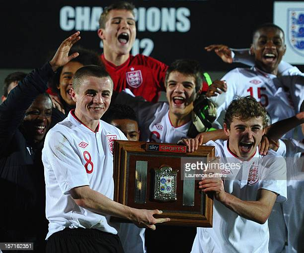 Jordan Rossiter of England celebrates with the trophy alongside Ryan Ledson after winning the The Sky Sport Victory Shield match between England u16...