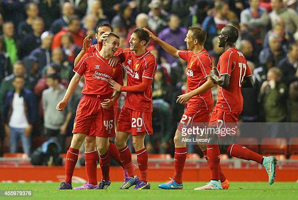 Jordan Rossiter of Liverpool celebrates with team mates after scoring the opening goal during the Capital One Cup Third Round match between Liverpool...