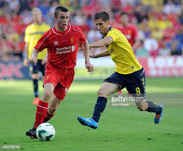 Jordan Rossitter of Liverpool competes with Alexander Szymanowski of Brondby IF during the preseason friendly match between Brondby IF and Liverpool...
