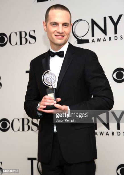 Jordan Roth poses in the 66th Annual Tony Awards press room at The Beacon Theatre on June 10 2012 in New York City