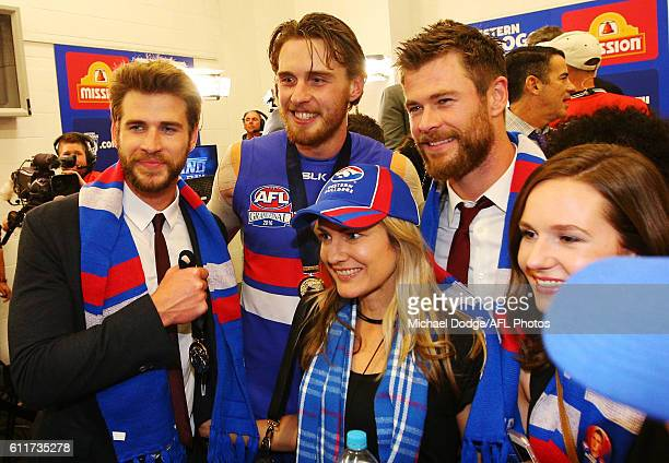Jordan Roughead of the Bulldogs celebrates the win with actors Liam Hemsworth and his brother Chris Hemsworth during the 2016 AFL Grand Final match...
