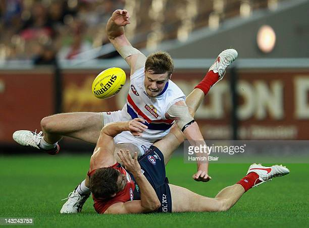 Jordan Roughead of the Bulldogs contests with Jared Rivers of the Demons during the round four AFL match between the Melbourne Demons and the Western...