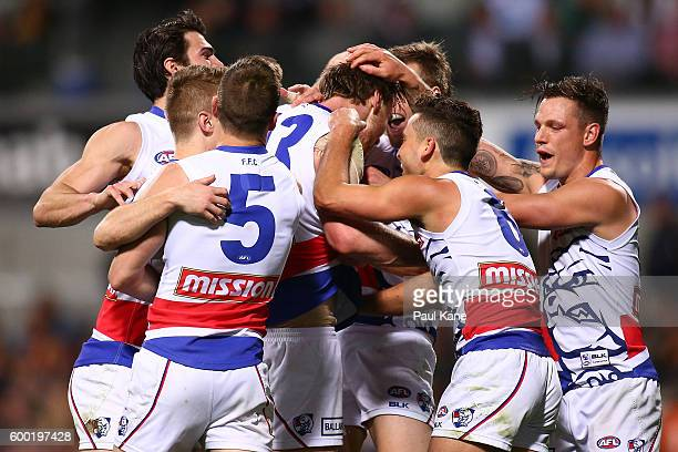 Jordan Roughead of the Bulldogs is congratulated by team mates after kicking a goal during the Second Elimination Final match between the West Coast...