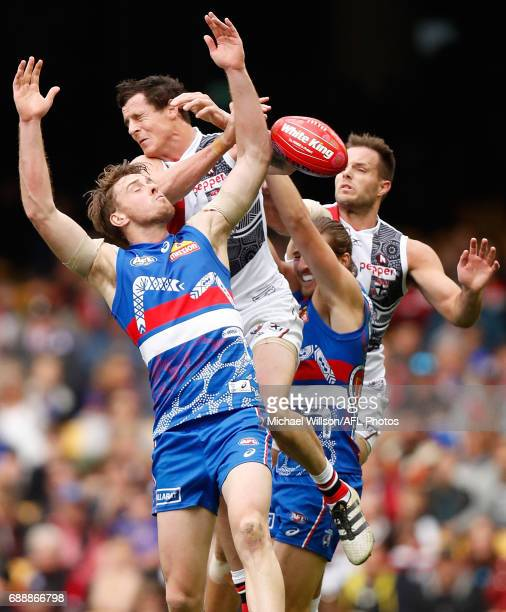 Jordan Roughead of the Bulldogs Jake Carlisle of the Saints Marcus Bontempelli of the Bulldogs and Nathan Brown of the Saints compete for the ball...