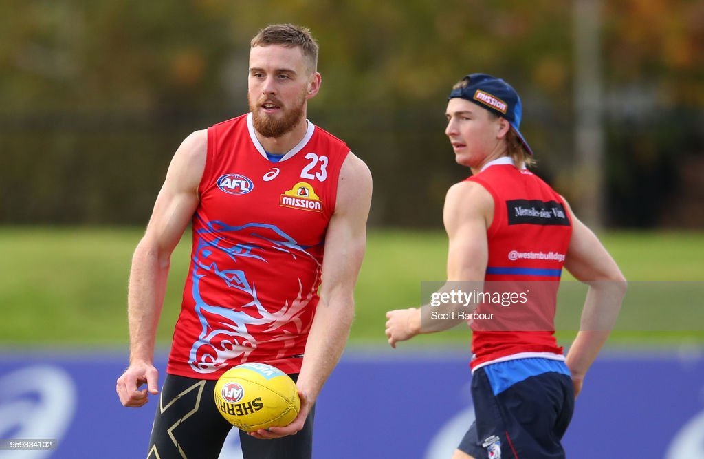 Jordan Roughead of the Bulldogs runs with the ball during a Western Bulldogs AFL training session at Whitten Oval on May 17, 2018 in Melbourne, Australia.