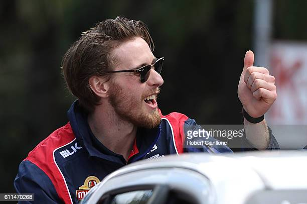 Jordan Roughead of the Bulldogs waves to fans during the 2016 AFL Grand Final Parade on September 30 2016 in Melbourne Australia