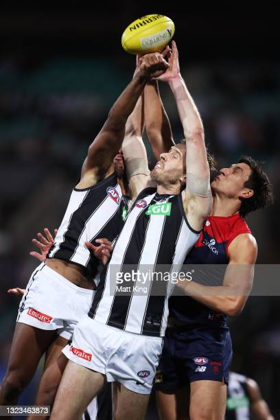 Jordan Roughead of the Magpies contests the ball during the round 13 AFL match between the Melbourne Demons and the Collingwood Magpies at Sydney...