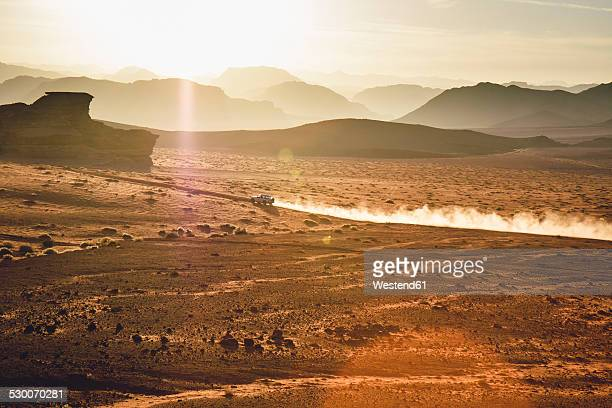 jordan, sand dust from a 4-wheeler in wadi rum desert - ヨルダン ストックフォトと画像