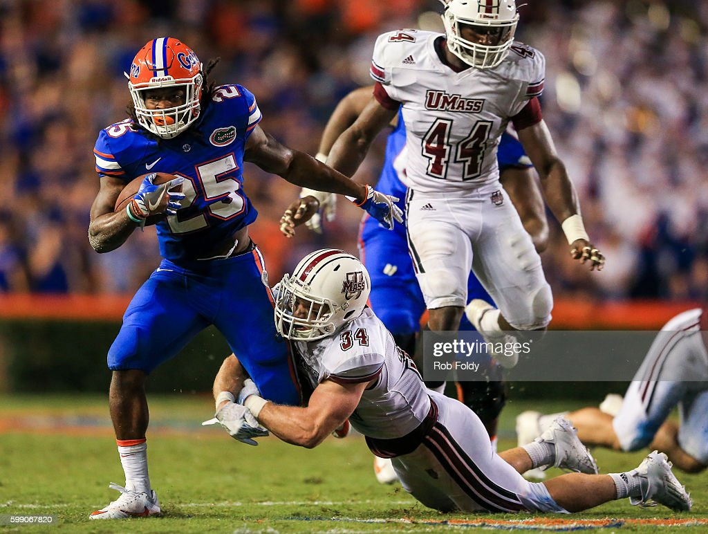 Jordan Scarlett #25 of the Florida Gators in action against Steve Casali #34 of the Massachusetts Minutemen during the second half of the game at Ben Hill Griffin Stadium on September 3, 2016 in Gainesville, Florida.