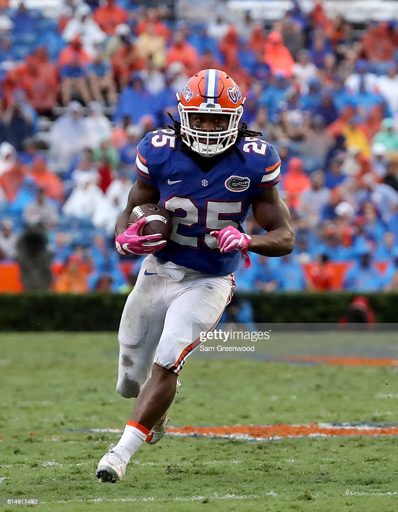 Jordan Scarlett #25 of the Florida Gators rushes for yardage during the game against the Missouri Tigers at Ben Hill Griffin Stadium on October 15, 2016 in Gainesville, Florida.