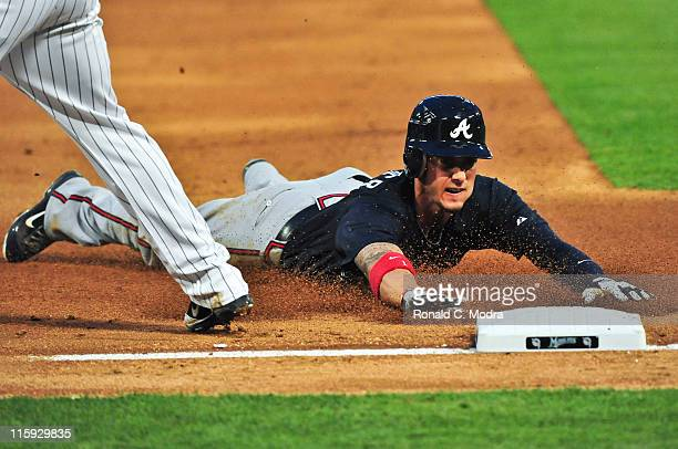 Jordan Schafer of the Altanta Braves slides into third base during a MLB game against the Florida Marlins at Sun Life Stadium on June 8 2011 in Miami...