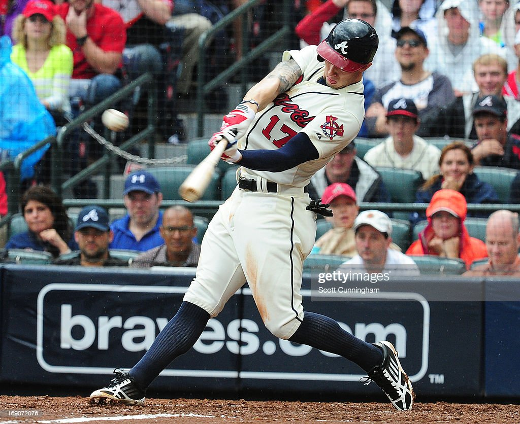 Jordan Schafer #17 of the Atlanta Braves lines a single to center to knock in a fifth inning run against the Los Angeles Dodgers at Turner Field on May 19, 2013 in Atlanta, Georgia.