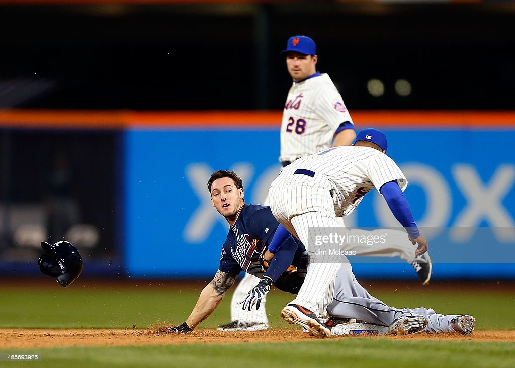 Jordan Schafer #17 of the Atlanta Braves steals second base in the ninth inning ahead of the tag from Ruben Tejada #11 of the New York Mets at Citi Field on April 19, 2014 in the Flushing neighborhood of the Queens borough of New York City.