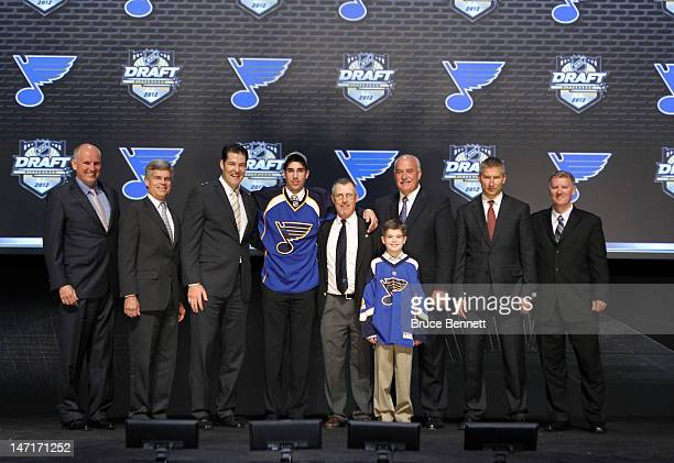 Jordan Schmaltz 25th overall pick by the St Louis Blues poses on stage with team representatives during Round One of the 2012 NHL Entry Draft at...