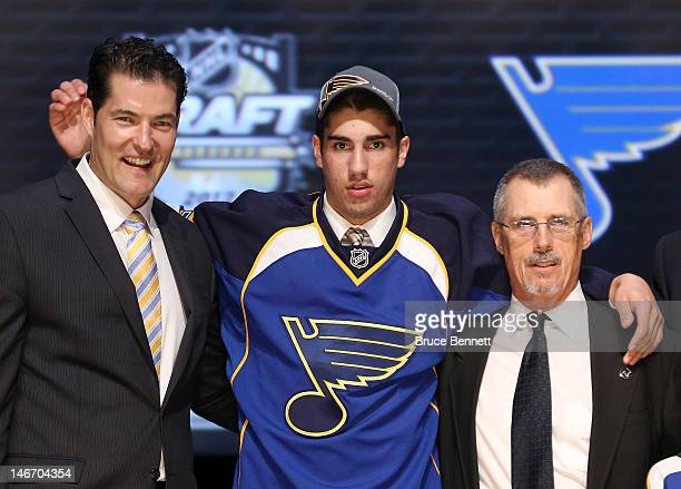 Jordan Schmaltz 25th overall pick by the St Louis Blues poses with Blues representatives on stage during Round One of the 2012 NHL Entry Draft at...
