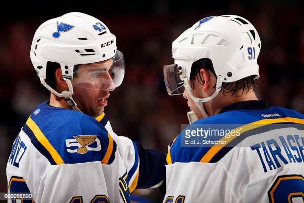 Jordan Schmaltz of the St Louis Blues chats with teammate Vladimir Tarasenko during a break in the action against the Florida Panthers at the BBT...