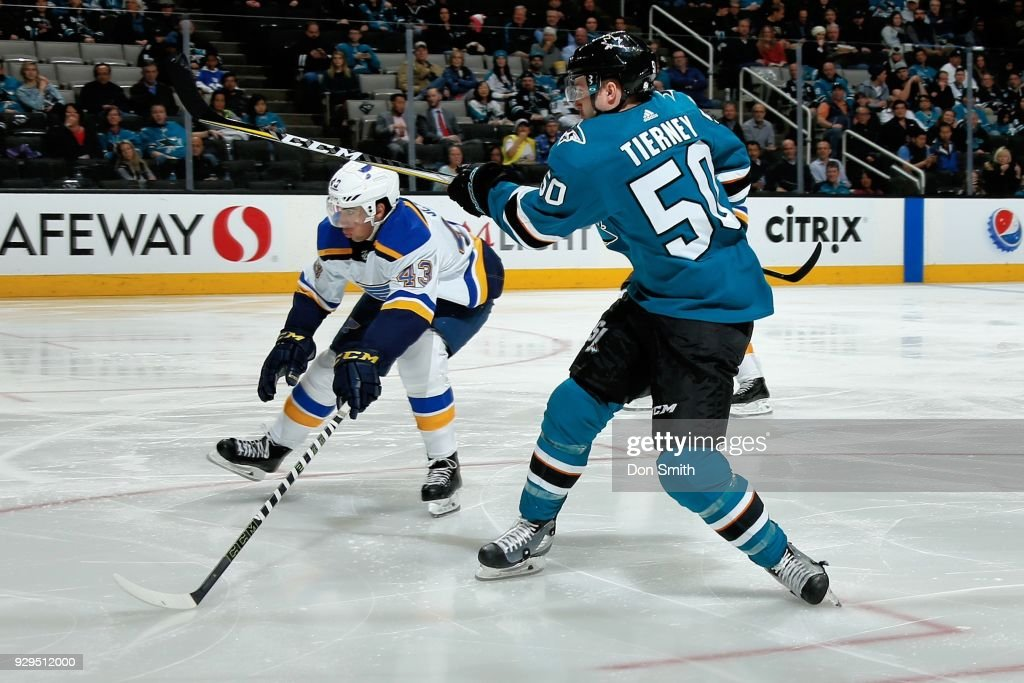 Jordan Schmaltz #43 of the St. Louis Blues tries to block a shot by Chris Tierney #50 of the San Jose Sharks at SAP Center on March 8, 2018 in San Jose, California.