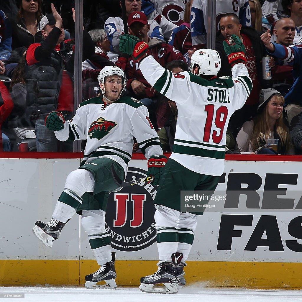 Jordan Schroeder #10 of the Minnesota Wild celebrates his goal against the Colorado Avalanche with Jarret Stoll #19 of the Minnesota Wild to take a 2-0 lead in the second period at Pepsi Center on March 26, 2016 in Denver, Colorado.