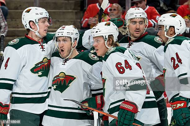 Jordan Schroeder of the Minnesota Wild yells out with teammates Mike Reilly Mikael Granlund Nino Niederreiter and Matt Dumba after Niederreiter...