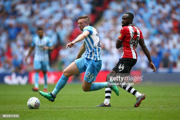 Jordan Shipley of Coventry City and Hiram Boateng of Exeter City in action during the Sky Bet League Two Play Off Final between Coventry City and...
