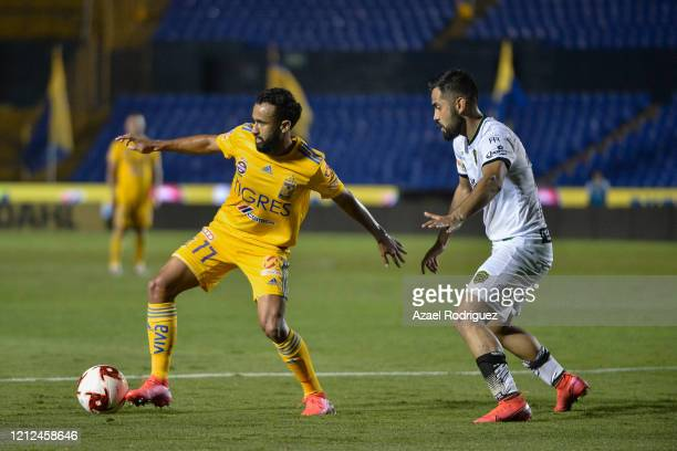 Jordan Sierra of Tigres fights for the ball with José Esquivel of Juárez during the 10th round match between Tigres UANL and FC Juarez as part of the...