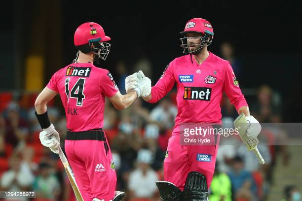 Jordan Silk and James Vince of the Sixers celebrate winning the Big Bash League match between the Adelaide Strikers and the Sydney Sixers at Metricon...