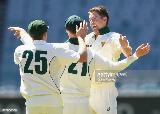 Jordan Silk and Tom Rogers of Tasmania celebrate taking the wicket of Daniel Christian of Victoria during day two of the Sheffield Shield match...