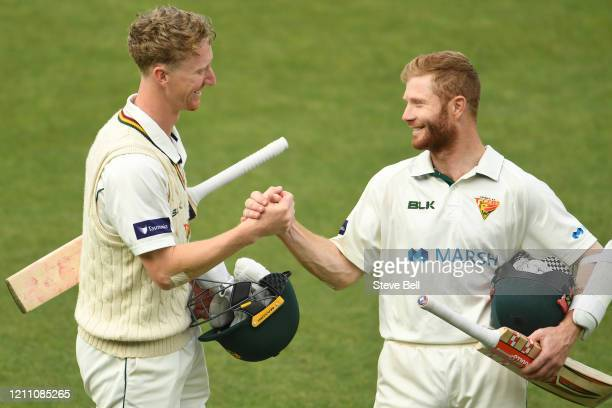 Jordan Silk of Tasmania and Charlie Wakim of Tasmania celebrate after the win during day three of the Sheffield Shield match between Tasmania and New...