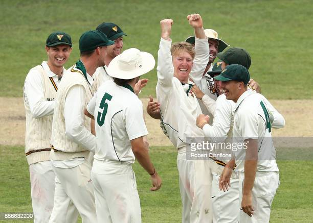 Jordan Silk of Tasmania celebrates taking the wicket of Peter Nevill of NSW during day four of the Sheffield Shield match between New South Wales and...