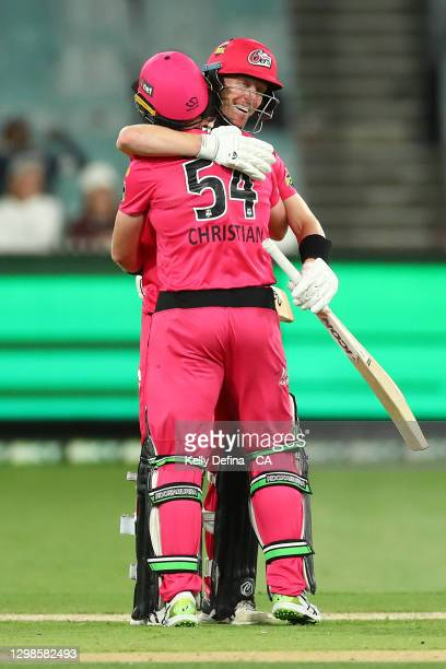Jordan Silk of the Sixers and Dan Christian of the Sixers celebrate winning during the Big Bash League match between the Melbourne Stars and the...