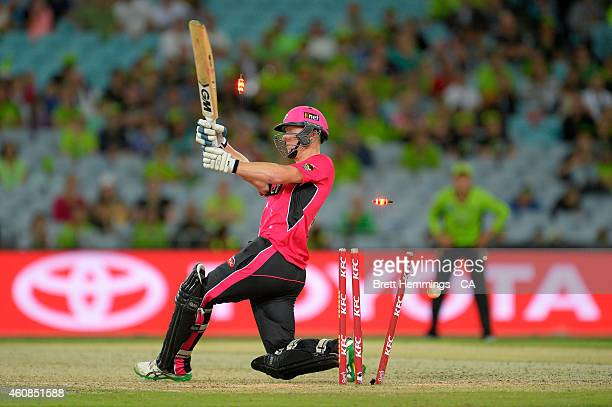 Jordan Silk of the Sixers is bowled out by Grinder Sandhu of the Thunder during the Big Bash League match between the Sydney Thunder and the Sydney...