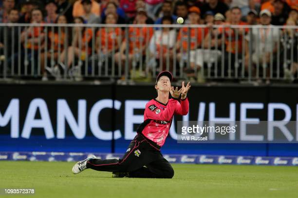 Jordan Silk of the Sixers takes a catch to dismiss Ashton Turner of the Scorchers off the bowling of Sean Abbott of the Sixers during the Big Bash...