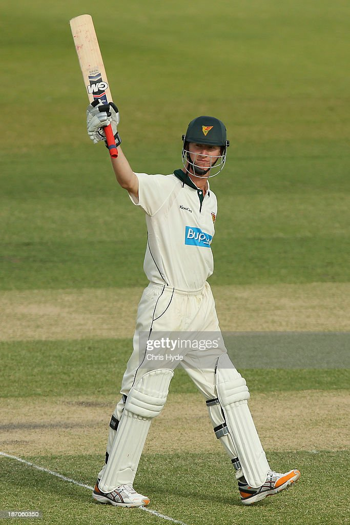 Jordan Silk of the Tigers celebrates his century during day one of the Sheffield Shield match between the Queensland Bulls and the Tasmania Tigers at Allan Border Field on November 6, 2013 in Brisbane, Australia.