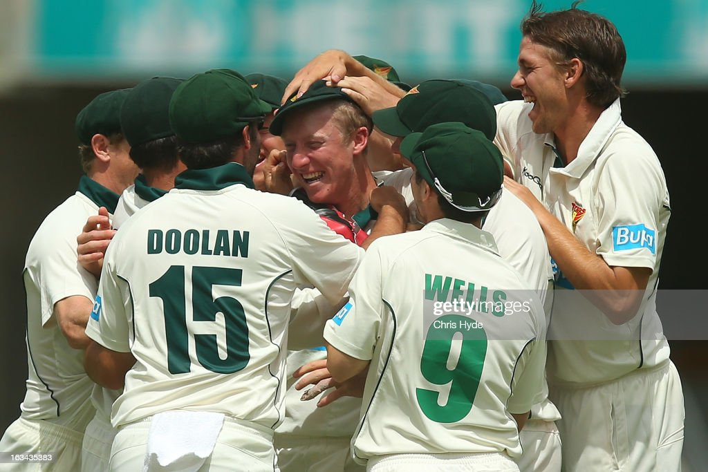 Jordan Silk of the Tigers celebrates with team mates after running out Joe Burns of the Bulls during day four of the Sheffield Shield match between the Queensland Bulls and the Tasmanian Tigers at The Gabba on March 10, 2013 in Brisbane, Australia.
