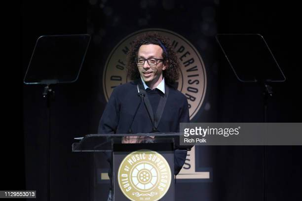 Jordan Silverberg winner of Best Music Supervision in a Film Trailer for 'SpiderMan Into the SpiderVerse' speaks onstage during the 9th Annual Guild...
