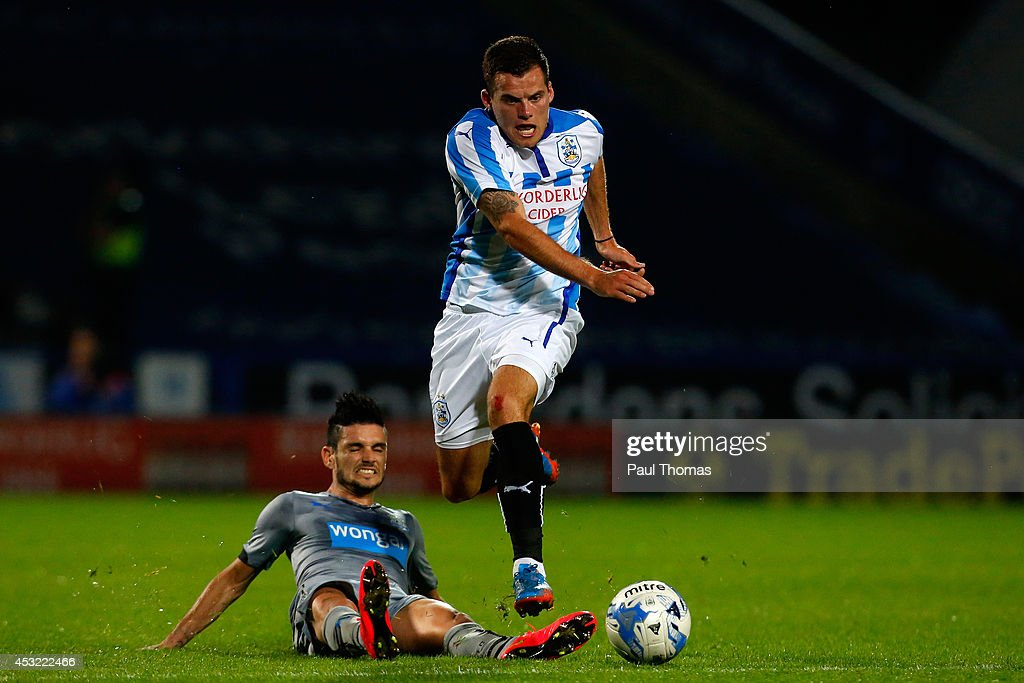 Jordan Sinnott (R) of Huddersfield in action with Remy Cabella of Newcastle during the Pre Season Friendly match between Huddersfield Town and Newcastle United at the John Smith's Stadium on August 5, 2014 in Huddersfield, England.