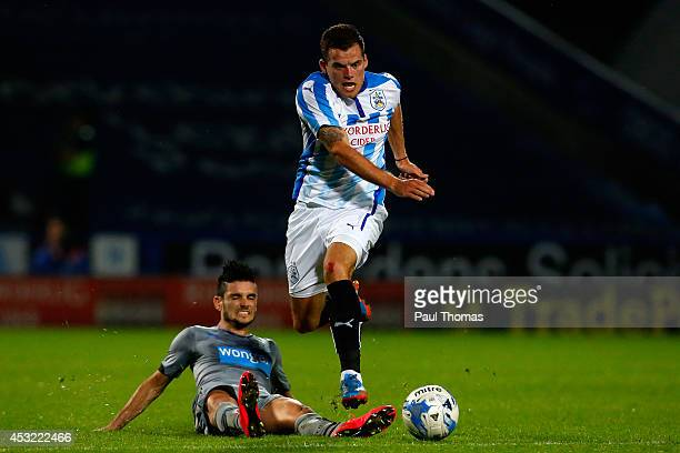 Jordan Sinnott of Huddersfield in action with Remy Cabella of Newcastle during the Pre Season Friendly match between Huddersfield Town and Newcastle...
