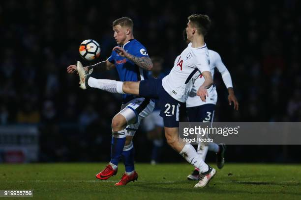 Jordan Slew of Rochdale AFC and Juan Foyth of Tottenham Hotspur in action during The Emirates FA Cup Fifth Round match between Rochdale and Tottenham...