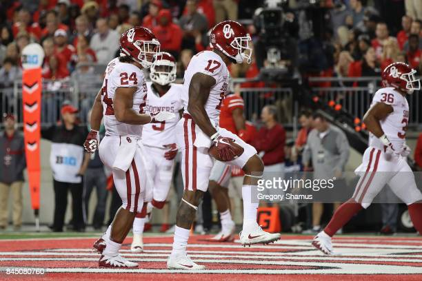 Jordan Smallwood of the Oklahoma Sooners celebrates scoring a touchdown during the fourth quarter against the Ohio State Buckeyes at Ohio Stadium on...