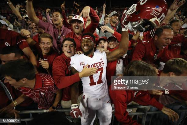 Jordan Smallwood of the Oklahoma Sooners celebrates with fans after defeating the Ohio State Buckeyes 31-16 at Ohio Stadium on September 9, 2017 in...