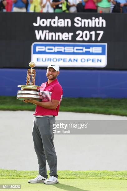 Jordan Smith of England celebrate with the trophy after the final round during the Green Eagle Golf Course on July 30 2017 in Hamburg Germany