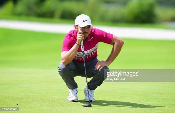 Jordan Smith of England lines up his putt on the 11th green during the Porsche European Open Day Four at Green Eagle Golf Course on July 30 2017 in...