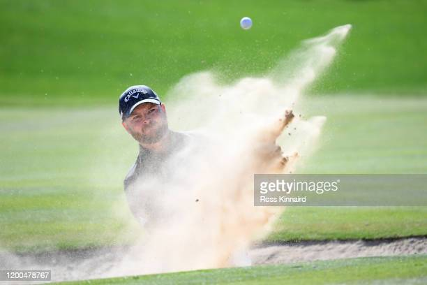 Jordan Smith of England plays a bunker shot for his third shot on the seventeenth during the final round on Day Four of the Abu Dhabi HSBC...