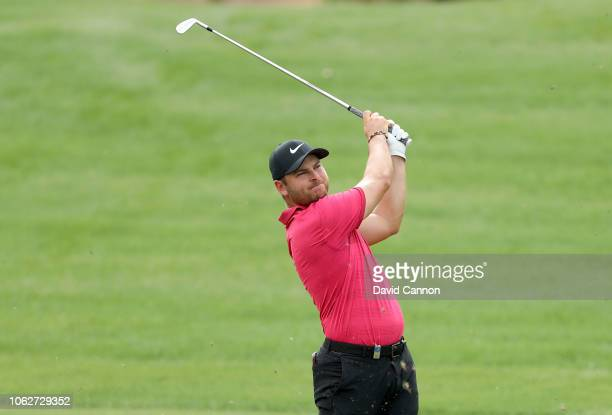 Jordan Smith of England plays his second shot on the par 4 third hole during the third round of the DP World Tour Championship on the Earth Course at...