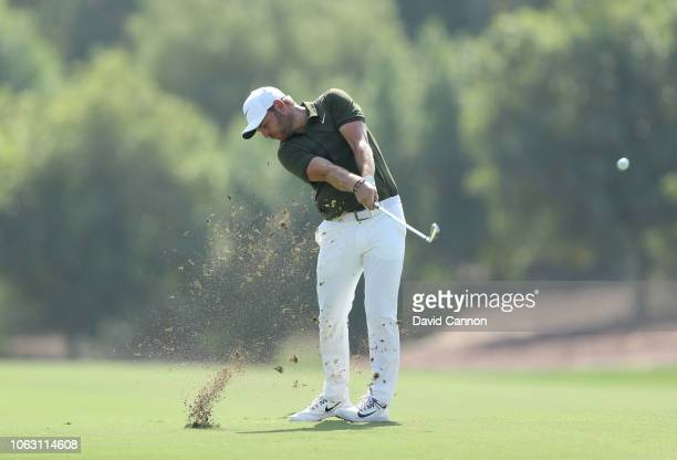 Jordan Smith of England plays his second shot on the par 4, third hole during the final round of the DP World Tour Championship on the Earth Course...