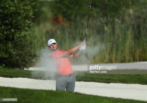 Jordan Smith of England plays his third shot from a bunker on the 11th hole during day two of the Porsche European Open at Green Eagle Golf Course on...