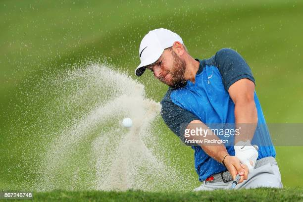 Jordan Smith of England plays his third shot from a bunker on the second hole during the third round of the WGC HSBC Champions at Sheshan...