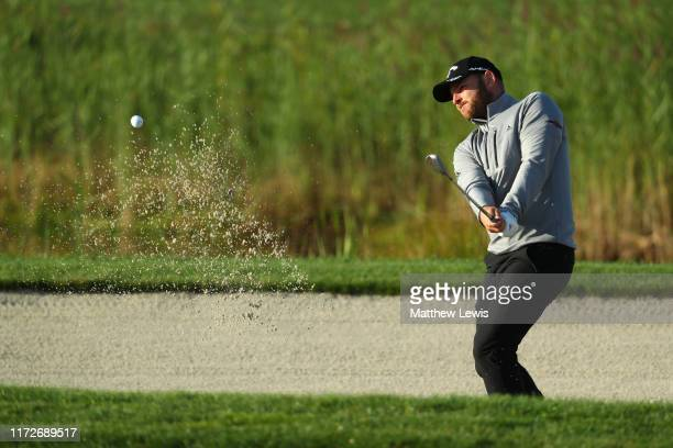 Jordan Smith of England plays out of the bunker on the 10th hole during Day 2 of the Porsche European Open at Green Eagle Golf Course on September...