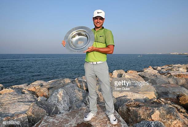 Jordan Smith of England poses with the Road to Oman Rankings trophy on day four of the NBO Golf Classic Grand Final at Al Mouj Golf on November 5...